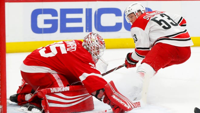 Jimmy Howard stops a shot by Hurricanes left wing Jeff Skinner in the third period of the Red Wings' 3-1 loss on Jan. 20 at Little Caesars Arena.