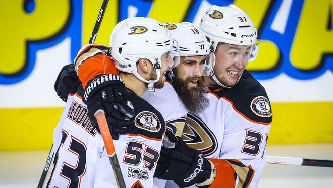 The Anaheim Ducks' Patrick Eaves (18) celebrates his goal with teammates against the Calgary Flames.