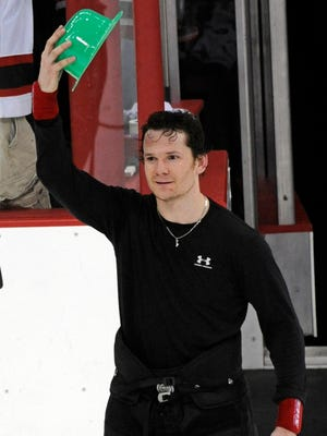 New Jersey Devils' Patrik Elias, of the Czech Republic, tips a green hat as he received the second star of the NHL hockey game against the Chicago Blackhawks on Tuesday, March 17, 2009 in Newark, N.J. The Devils won 3-2. Elias had an assist which gave him career 702 points, the most points in Devils history.