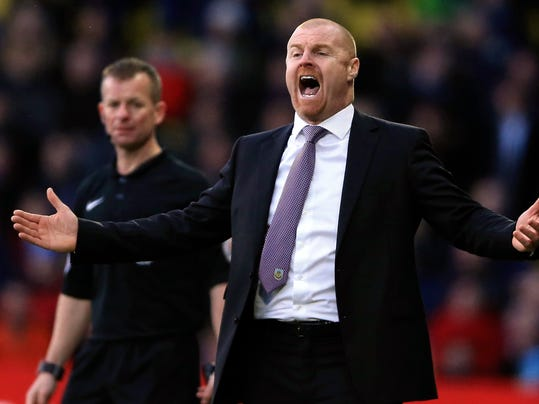 Burnley manager Sean Dyche protests during the English Premier League soccer match against Watford at Vicarage Road, Watford, England, Saturday Feb. 4, 2017. (Nigel French/PA via AP)