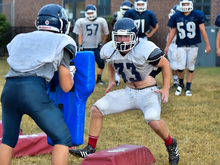 Chambersburg's Clay Myers runs through a drill on Tuesday,