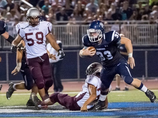Chambersburg's Clay Myers charges away from Shippensburgs
