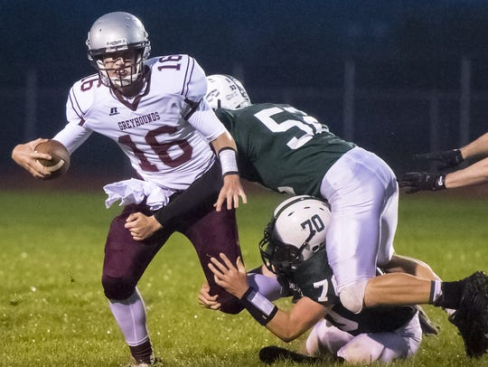 James Buchanan's Sean Bankson (52) gets in on a tackle