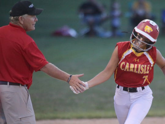 Carlilse's Alyvia Dubois rounds third after hitting a home run.