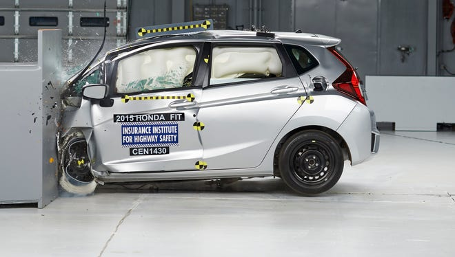 "Honda's 2015 Fit small car gest good crash test score after new bumper design. Car is shown adequately protecting the passenger compartment in ""small offset"" crash test. Owners of 2015 Fits made before the change get free  upgraded bumper structures."