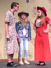 """From left, Todd Petrie, Claire Dugenske and Elizabeth Brunette rehearse St. Mary's Springs Academy's production of """"Annie Play Will Do."""""""
