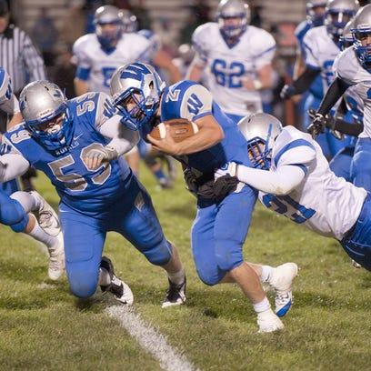 Wynford quarterback Zach Hoffman drags a Bishop Ready