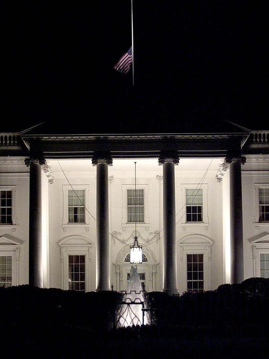 The American flag over the White House f