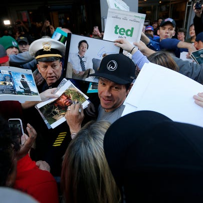 Mark Wahlberg is in surrounded by fans as for a private
