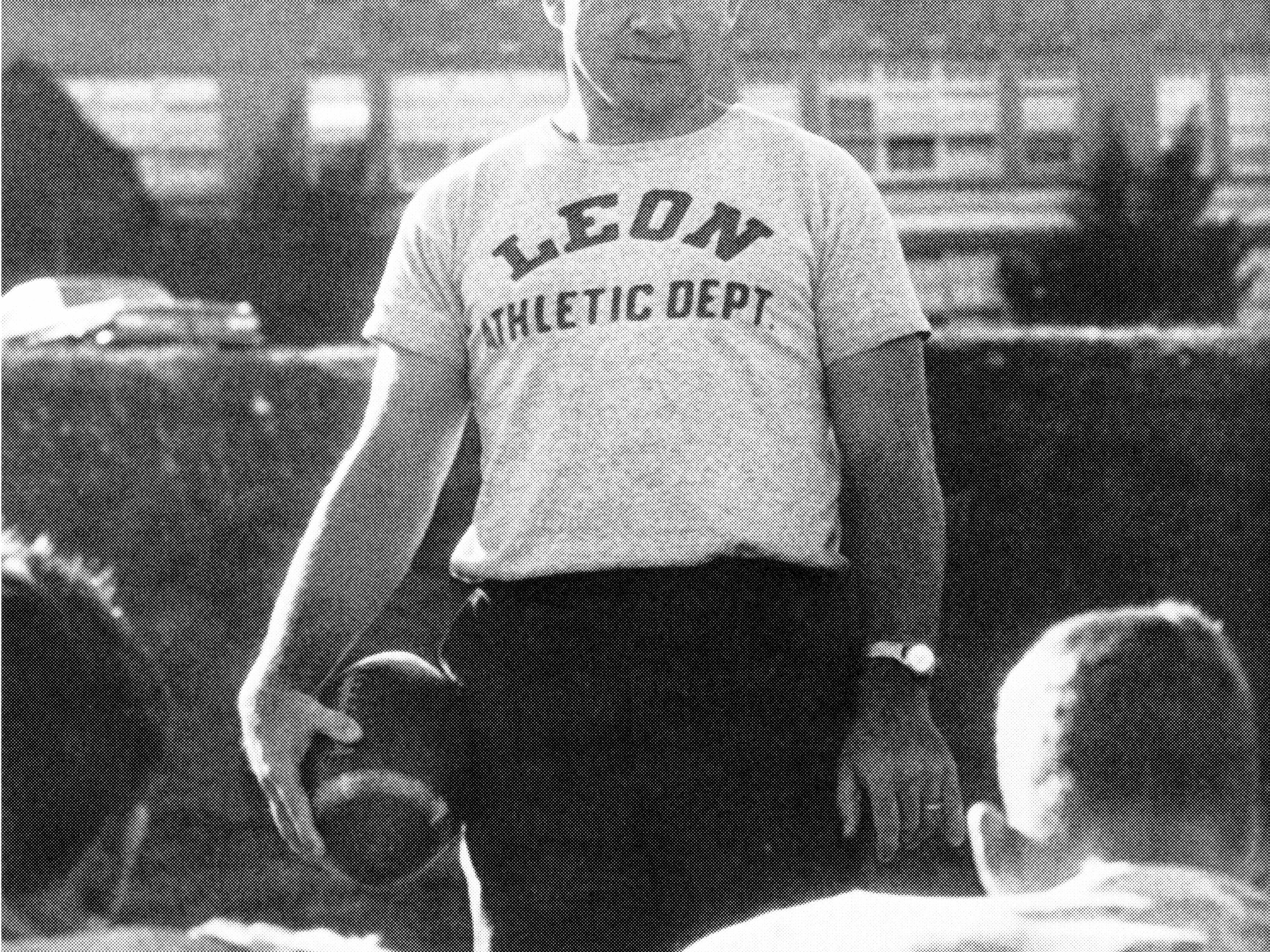 Legendary Leon High coach Gene Cox addresses a team of Lions players in the mid-1960s.