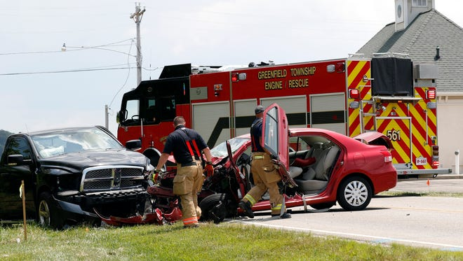 """Greenfield Township Firefighters clean the scene of a crash Tuesday afternoon, July 10, 2018, in the 2700 block North Columbus Street in Lancaster. Three people were taken to area hospitals as a result of the crash according to GTFD Capt. Brad Smith. The driver of a black Dodge truck was taken to Fairfield Medical Center with minor injuries. Smith said one person in the red Toyota sedan was flown to Ohio State Wexner Medical Center and the other was taken to Grant Medical Center. Smith said both patients had moderate to major injuries. Ohio Highway Patrol Trooper D.J. Robers wouldn't provide any details about the crash only saying it was """"under investigation."""""""