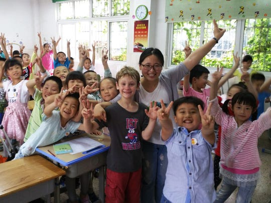 """Associate professor Sandra Way's son with his class in Nanjing, China. She accompanied her son with his school's dual language program exchange and will be speaking on her encounters as a sociologist and a mother in her upcoming talk """"The Universal Language of Rock, Paper, Scissors: Reflections on a Chinese Elementary School Exchange."""""""