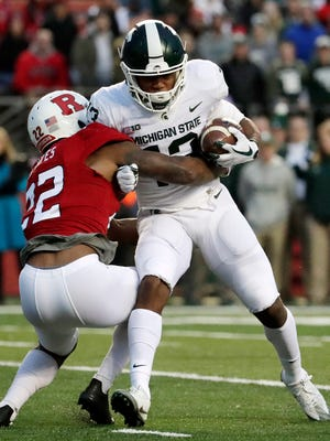 Michigan State's Laress Nelson is tackled by Rutgers' Damon Hayes in the first half Saturday, Nov. 25, 2017 in Piscataway, N.J.