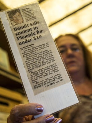 Beckie Miller digs for old newspapers clippings about when her son was murdered.