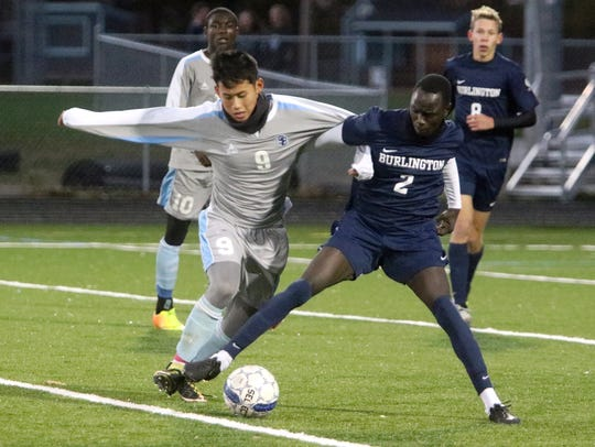 Senior Tenzin Choedak, left, is a key returning midfielder for the defending-champion South Burlington Wolves.