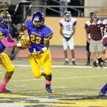 Hattiesburg's Fabian Franklin receives the handoff during a game against Picayune Friday at Hattiesburg High School.