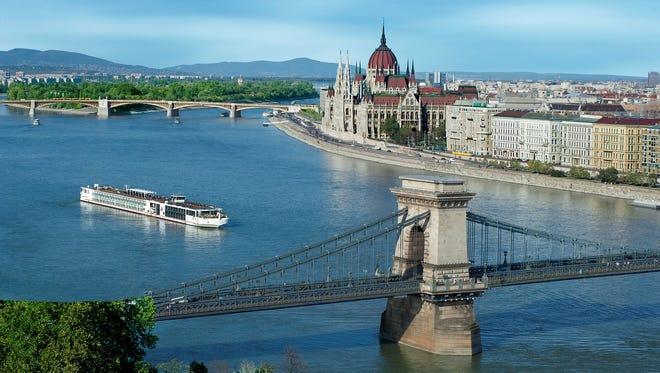 A Viking river ship sails on the Danube River past Budapest, Hungary.