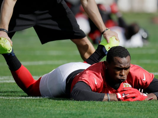 Atlanta Falcons wide receiver Julio Jones (11) stretches during a practice for the NFL Super Bowl 51 football game Wednesday, Feb. 1, 2017, in Houston. Atlanta will face the New England Patriots in the Super Bowl Sunday. (AP Photo/Eric Gay)