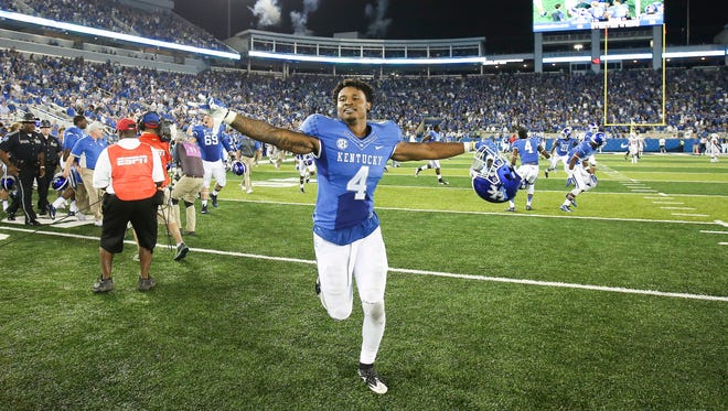 Kentucky running back Mikel Horton, a Lakota West grad, celebrates as he runs off the field after he scored the winning touchdown over Louisiana-Lafayette.