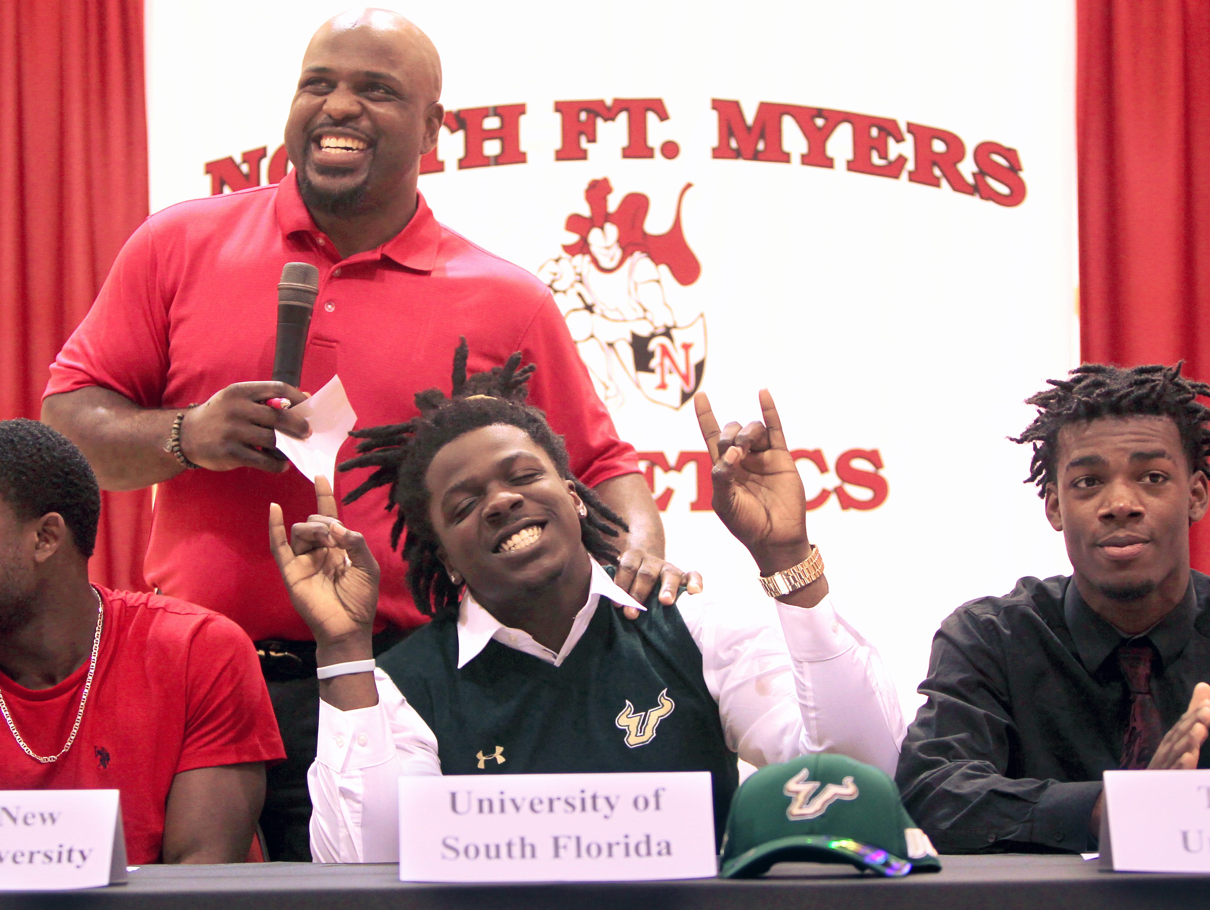 North Fort Myers head football coach Earnest Graham, top, celebrates football player Mi'Cario Stanley's commitment to the University of South Florida Wednesday during National Signing Day.