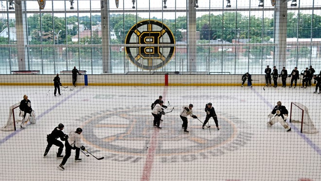 Boston Bruins players scrimmage on a shortened playing area during NHL hockey camp, Monday, July 13, 2020, in Boston.