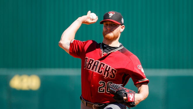 Diamondbacks pitcher Shelby Miller warms up before the inning starts as the Arizona Diamondbacks face off against the Los Angeles Angels on Thursday, March 10, 2016, in at Diablo Stadium in Tempe, Ariz. Diamondbacks beat the Angels 5-3.