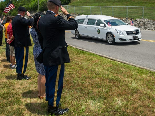 A hearse carrying the remains of U.S. Army Sgt. Eric