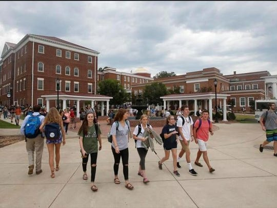 In this Sept. 7, 2016, file photo, Longwood University students walk to class at the school in Farmville, Virginia. The school is hosting the vice presidential debate on Oct. 4.