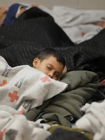 This June 18, 2014, file photo, detainees sleep in