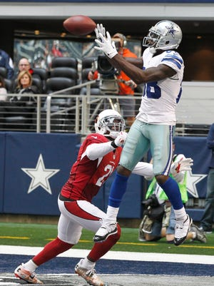 Dallas Cowboys wide receiver Dez Bryant (88) catches a touchdown pass in the fourth quarter while defended by Arizona Cardinals cornerback Patrick Peterson (21)  at AT&T Stadium. Arizona beat Dallas 28-17.