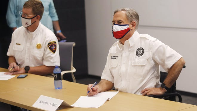 Texas Governor Greg Abbott attended a Lubbock Covid-19 Briefing with local officials in the Citizen's Tower in August. [Mark Rogers/file photo]