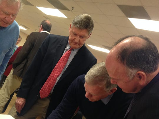 Former Delegate John Bohanan, second from right, signs one of many resolutions circulated Sunday at a tribute to former state delegate Norm Conway. Looking on from left to right are former Maryland state Sen. Larry Levitan, Somerset County Judge Daniel Long and former state Senate candidate Chris Robinson.