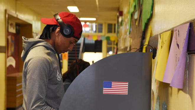 Paul Ward, 18, of the City of Poughkeepsie, votes in his first election at Samuel F. B. Morse Elementary School.