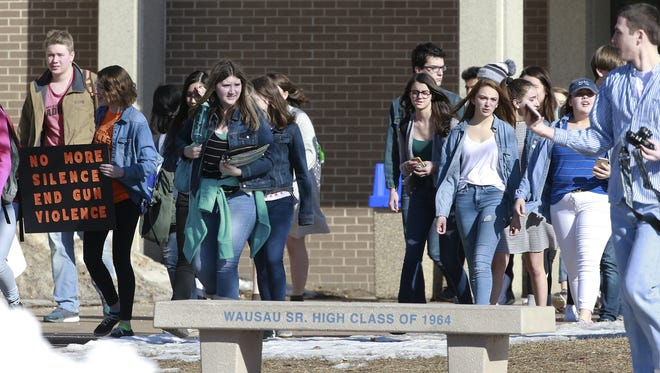 Students participate in the nationwide school walkout protests Wednesday, March 14, 2018, at Wausau West High School in Wausau, Wis.