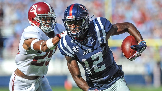 Ole Miss receiver Van Jefferson (12) posted six receptions for 91 yards in his SEC debut against Alabama.
