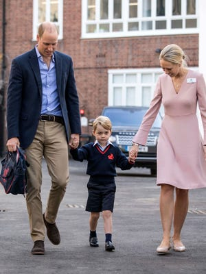 Britain's Prince George, center, arrives for his first day of school at Thomas's school in Battersea in London.