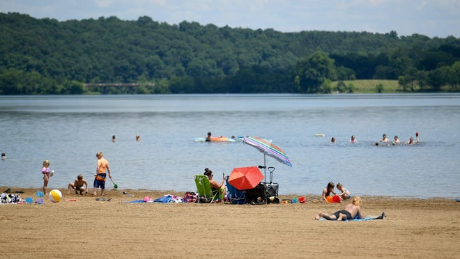 Visitors to Salt Fork State Park Beach Tuesday, June 30, 2020.