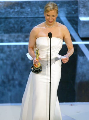 Renee Zellweger accepts her best supporting actress award at the 2004 Academy Awards.