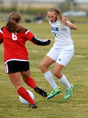 Great Falls High's Rian Habel defends against Bozeman's