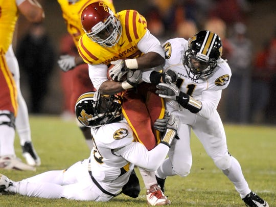 Iowa State's Alexander Robinson is wrapped up by Missouri
