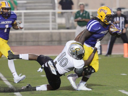 Calvary's Frederick Davis (10) attempts to tackle Byrd's Trayveon Allen in a game last fall.