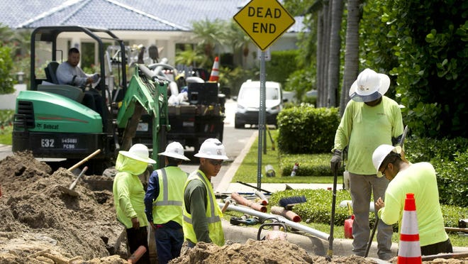 Wilco employees prepare to lay conduit for the underground utilities in the area of Mediterranean Road and North Lake Way in 2018 in Palm Beach.