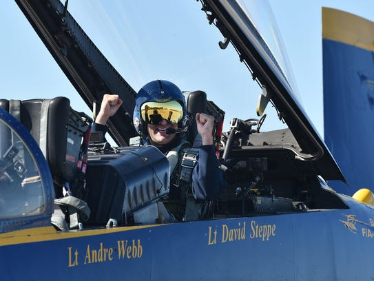 TCPalm editor Adam Neal reacts after his Blue Angels