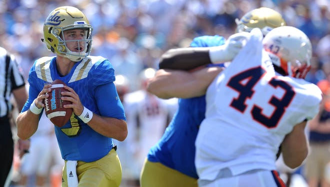 September 5, 2015; Pasadena, CA, USA; UCLA Bruins quarterback Josh Rosen (3) looks to pass against the Virginia Cavaliers during the first half at the Rose Bowl. Mandatory Credit: Gary A. Vasquez-USA TODAY Sports