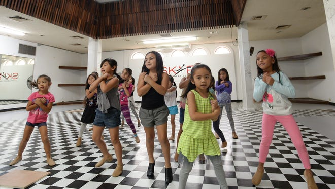 Beginning Jazz students go over routines during a class at the SKIP Entertainment Company studio in Hagåtña on Feb. 13.