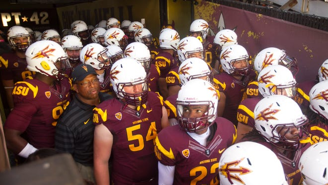 ASU gets ready to take the field before the PAC-12 college football game against Washington State at Sun Devil Stadium in Tempe on Nov. 22, 2014.