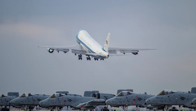 Air Force One departs past a squadron of Fairchild Republic A-10 Thunderbolt II (Warthog) jets at Gowen Field in Boise, Idaho, on Wednesday, Jan. 21, 2015.