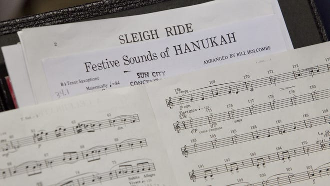 Sheets of Christmas music at a band rehearsal in Sun City.