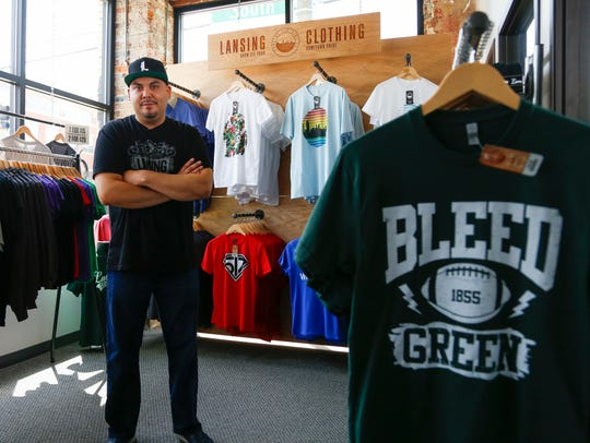 Jeremy Helton, owner of Lansing Clothing Co., in his