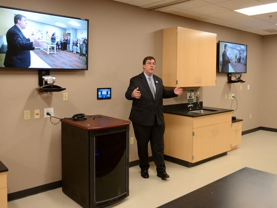 Dr. Matthew Hunsaker, gives a tour of the new Medical College of Wisconsin campus in Green Bay, located at St. Norbert College on Thursday. Hunsaker is the campus dean for the Medical College of Wisconsin in Green Bay.